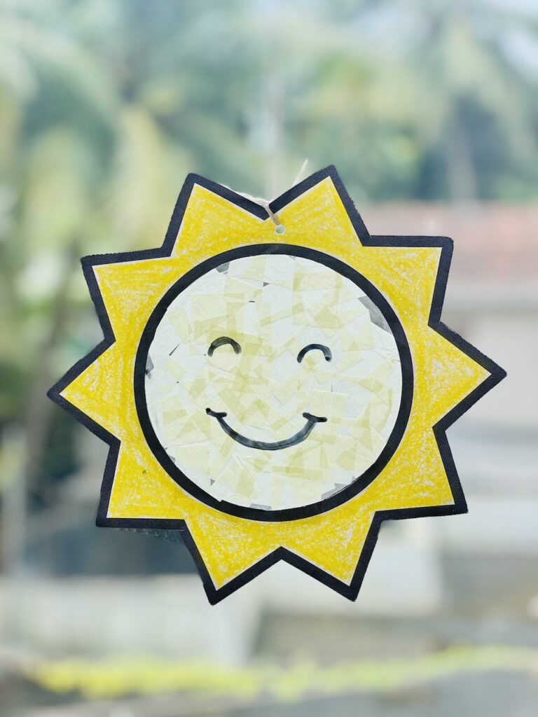 Suncatcher craft for kids with tissue paper (free template available)