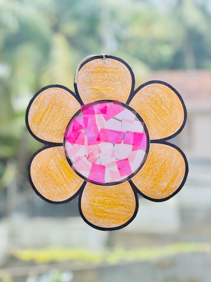 easy tissue paper suncatcher craft for kids step-by-step tutorial - flower shaped sun catcher