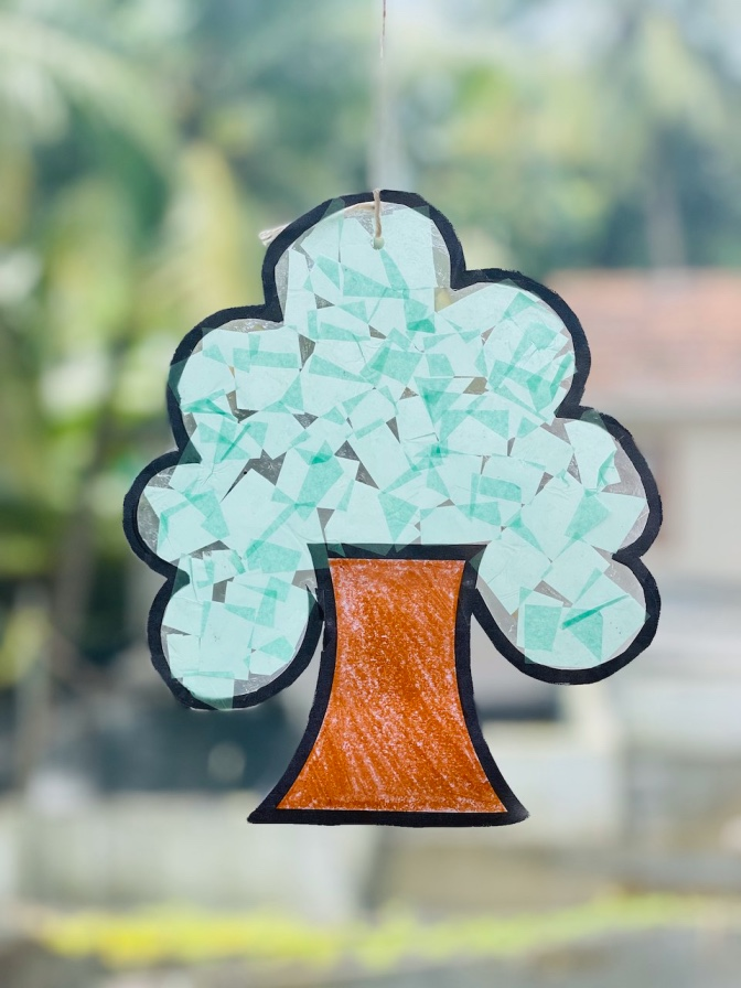 easy tissue paper suncatcher craft for kids step-by-step tutorial - tree shaped sun catcher